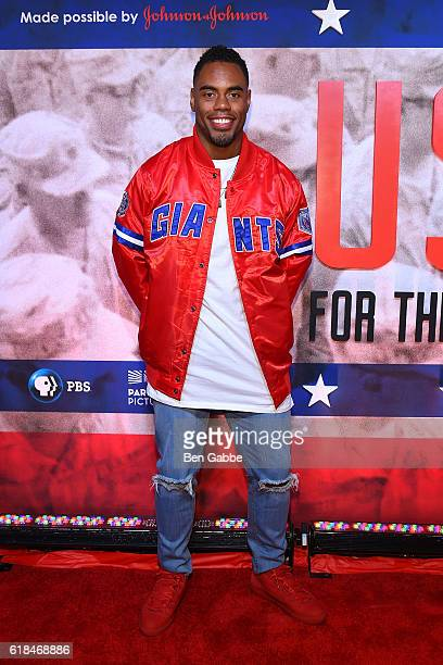 """Pro NFL running back Rashad Jennings attend the USO 75th Anniversary """"USO For The Troops"""" Screening at Intrepid Sea-Air-Space Museum on October 26,..."""