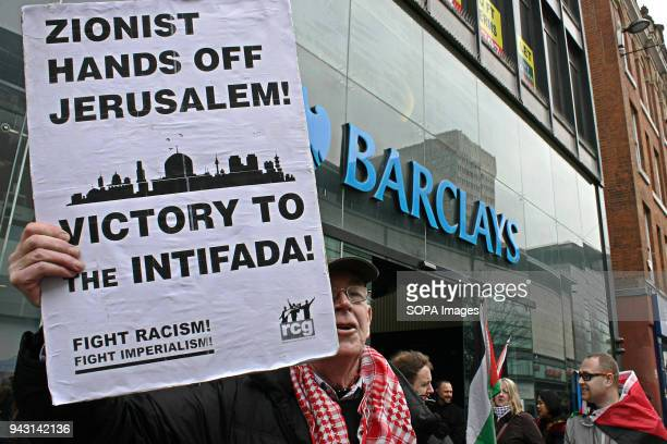 S BANK MANCHESTER LANCASHIRE UNITED KINGDOM A Pro Palestine Protest holds aloft a Zionist Hands Off Jerusalem placard outside Barclay's Bank in...