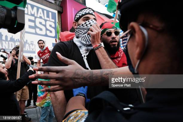 Pro Palestinian protesters face off with a group of Israel supporters and police in a violent clash in Times Square on May 20, 2021 in New York City....