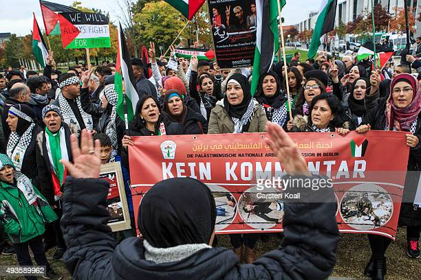 Pro Palestinian protesters gather to protest against the visit of Israeli Prime Minister Benjamin Netanyahu at the Chancellery on October 21 2015 in...