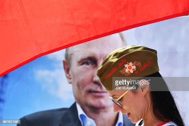 TOPSHOT A pro Putin protester demonstrates in front of the Presidential palace in the Vienna Hofburg Austria on June 5 2018 prior Russian President's...