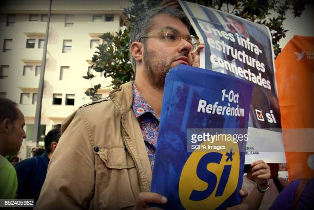 A pro referendum supporters is seen holding a placard during a protest a week before the final vote for the independence of Catalonia A group of...