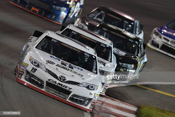 Pro Series driver Hailie Deegan Toyota Camry leads a pack of cars through turn three during the Gateway Classic 150 presented by the West Coast Stock...