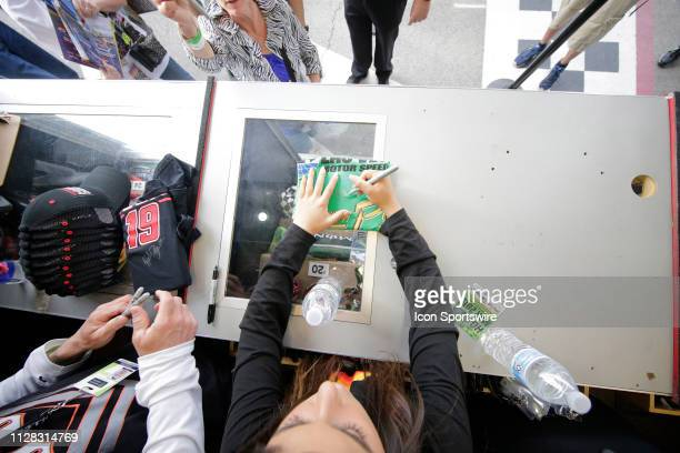 Pro Series West driver Hailie Deegan signs autographs in the midway of LVMS during qualifying for the Monster Energy NASCAR Cup Series Pennzoil 400...