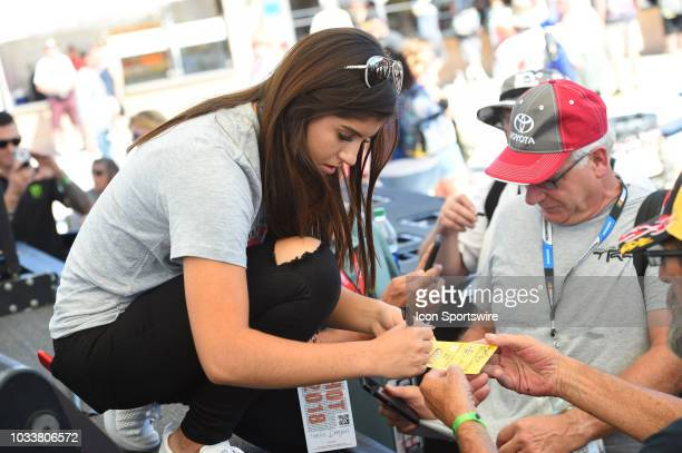 Pro Series West driver Hailie Deegan signs autographs in the Neon Garage during practice for the South Point 400 Monster Energy NASCAR Cup Series...