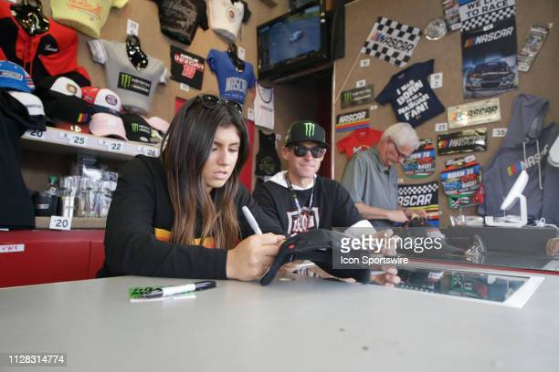 Pro Series West driver Hailie Deegan signs autographs with her father Brian Deegan in the midway of LVMS during qualifying for the Monster Energy...