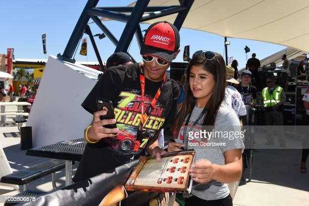 Pro Series West driver Hailie Deegan take a selfie with a fan andsigns autographs in the Neon Garage during practice for the South Point 400 Monster...