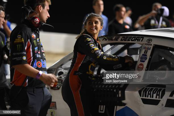 Pro Series West driver Hailie Deegan Toyota Camry gets into her car during the NASCAR KN West Series Star Nursery 100 on September 13 at The Dirt...