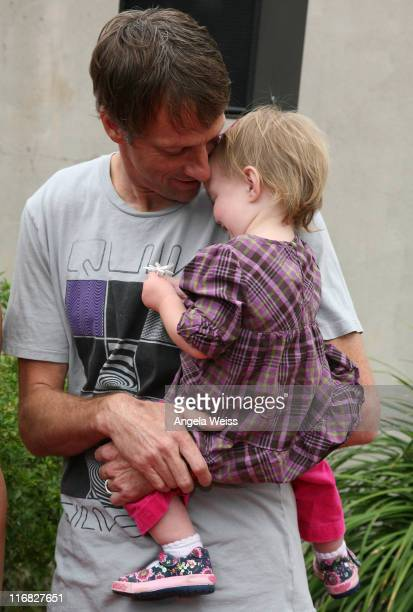 Pro Skateboarder Tony Hawk and his daughter Kadence Clover Hawk arrive to the 'Tony Hawk Ride Presents Stand Up For Skateparks' Benefit held at the...