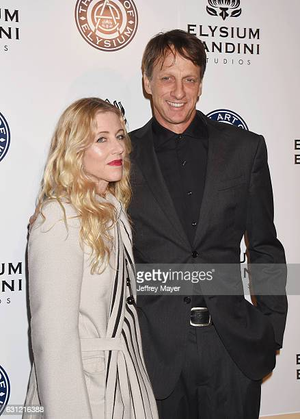 Pro skateboarder Tony Hawk and wife Catherine Goodman arrive at The Art of Elysium presents Stevie Wonder's HEAVEN Celebrating the 10th Anniversary...