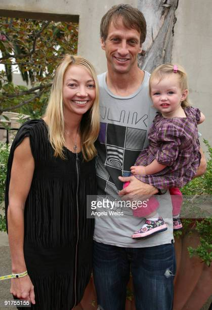 Pro Skateboarder Tony Hawk his wife Lhotse Merriam and their daughter Kadence Clover Hawk arrive to the 'Tony Hawk Ride Presents Stand Up For...