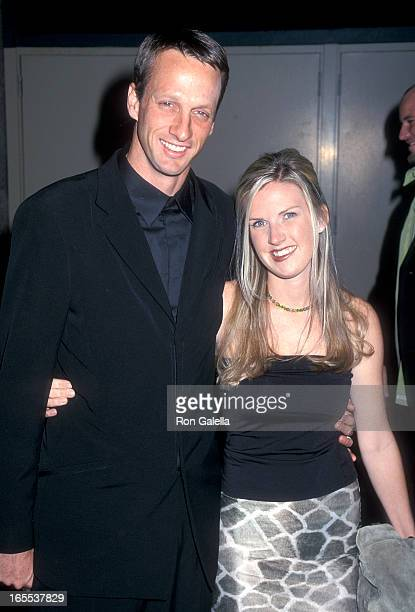 Pro skater Tony Hawk and wife Erin Lee attend the 11th Annual Billboard Music Awards on December 5 2000 at the MGM Grand Garden Arena in Las Vegas...