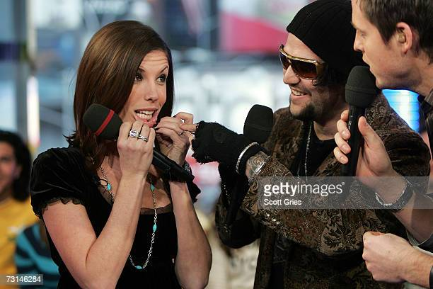Pro skaterboarder Bam Margera and his fiance Melissa Missy Rothstein show off their new tattoos to host Damien Fahey onstage during MTV's Total...
