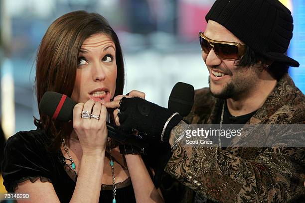 Pro skaterboarder Bam Margera and his fiance Melissa Missy Rothstein show off their new tattoos onstage during MTV's Total Request Live at the MTV...
