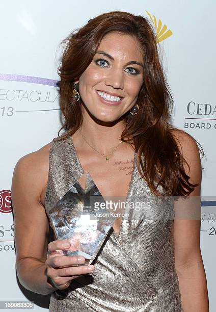 Pro soccer player and honoree Hope Solo poses backstage with the Female Athlete of the Year award at the 28th Anniversary Sports Spectacular Gala at...