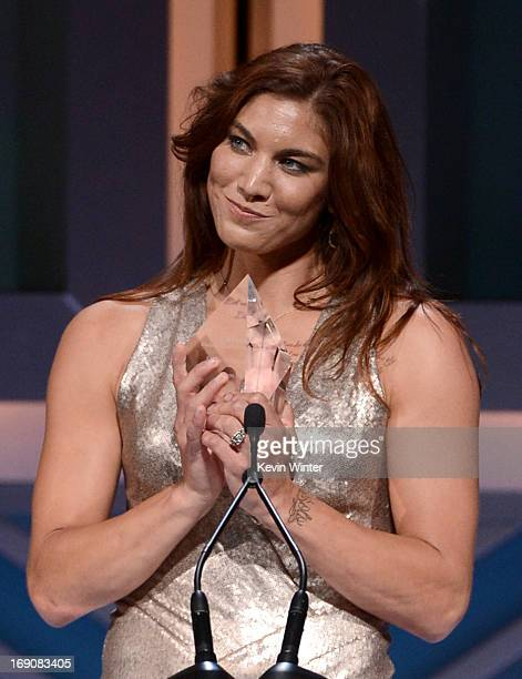 Pro soccer player and honoree Hope Solo receives the Female Athlete of the Year award at the 28th Anniversary Sports Spectacular Gala at the Hyatt...