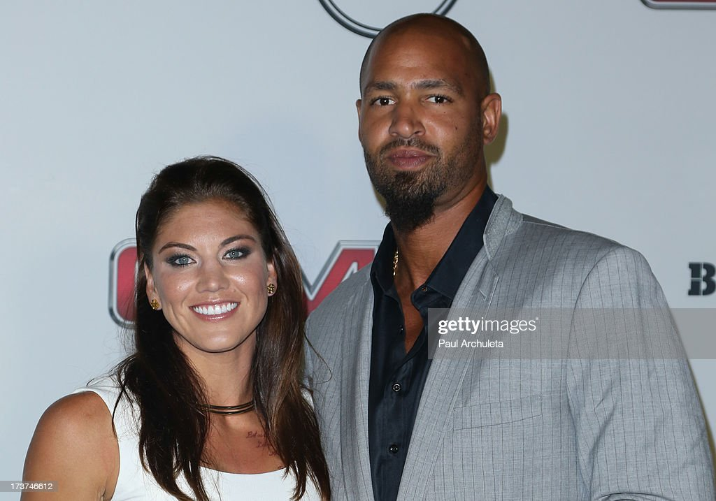 Pro Soccer Player Hope Solo (L) and Former NFL Player Jerramy Stevens (R) attend the ESPN's 5th Annual Body At ESPYS at Lure on July 16, 2013 in Hollywood, California.