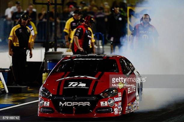 Pro Stock Car driver Erica Enders heads down the track during a qualifying run at day one of the MoPar Mile High Nationals at Bandimere Speedway on...