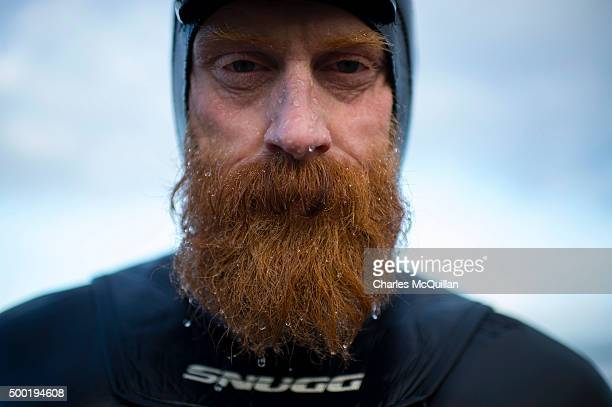 Pro surfer Alastair Mennie poses for a portrait after emerging from the sea during Storm Desmond on December 6 2015 in Portrush Northern Ireland...