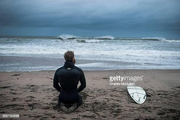 Pro surfer Alastair Mennie watches the sea as he prepares to surf Storm Desmond on December 6 2015 in Portrush Northern Ireland Storm Desmond has...