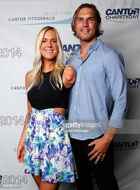 Pro surfer Bethany Hamilton and Adam Dirks attend Annual Charity Day Hosted By Cantor Fitzgerald And BGC at Cantor Fitzgerald on September 11 2014 in...