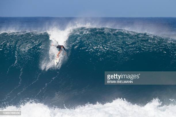 US pro surfer Brett Barley surfs Banzai Pipeline ahead of the Billabong Pipe Masters on the north shore of Oahu in Hawaii on December 6 2018 /...