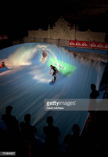 Pro surfer Chris Miller rides the stationary artificial wave dubbed Bruticus Maximus as night falls August 27 2000 at Mission Beach in San Diego CA...