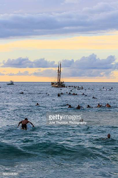 Pro surfer invitees and alternates paddle out for a blessing at the 29th annual Quicksilver In Memory of Eddie Aikau big wave invitational surfing...