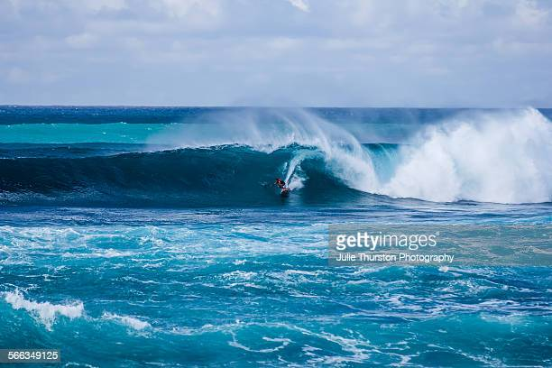 Pro surfer Kala Alexander rides a large wave at the Sunset Beach Pro Standup World Tour standup paddle competition held at famous surf break Sunset...