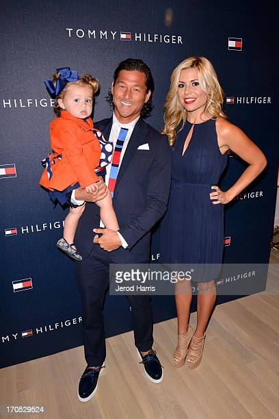 Pro surfer Kalani Robb wife Kortney Robb and daughter Kea Robb attend the grand opening of the Tommy Hilfiger store at Fashion Valley Mall on June 13...