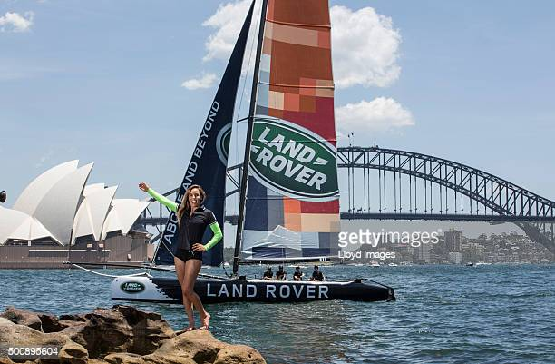 Pro surfer Sally Fitzgibbons next to the LandRover extreme 40 catamaran in Sydney Harbour prior to racing during the 2015 Extreme Sailing Series on...