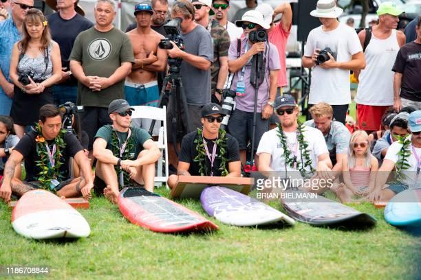 Pro surfers Eli Olsen Nathan Florence Koa Rothman and John John Florence take part in the opening ceremony of the 2019 Eddie Aikau Big wave...