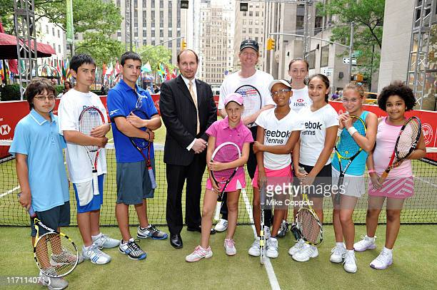 Pro Tennis Player Jim Courier HSBC Bank USA EVP Ashley Parker and junior players attend CityParks Foundation Kids Tennis Clinic As Part Of HSBC Bank...