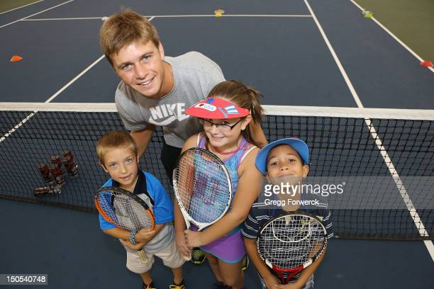 Pro tennis player Ryan Harrison from Austin Texas poses with young players during a tennis clinic at the WinstonSalem Open at the Wake Forest...