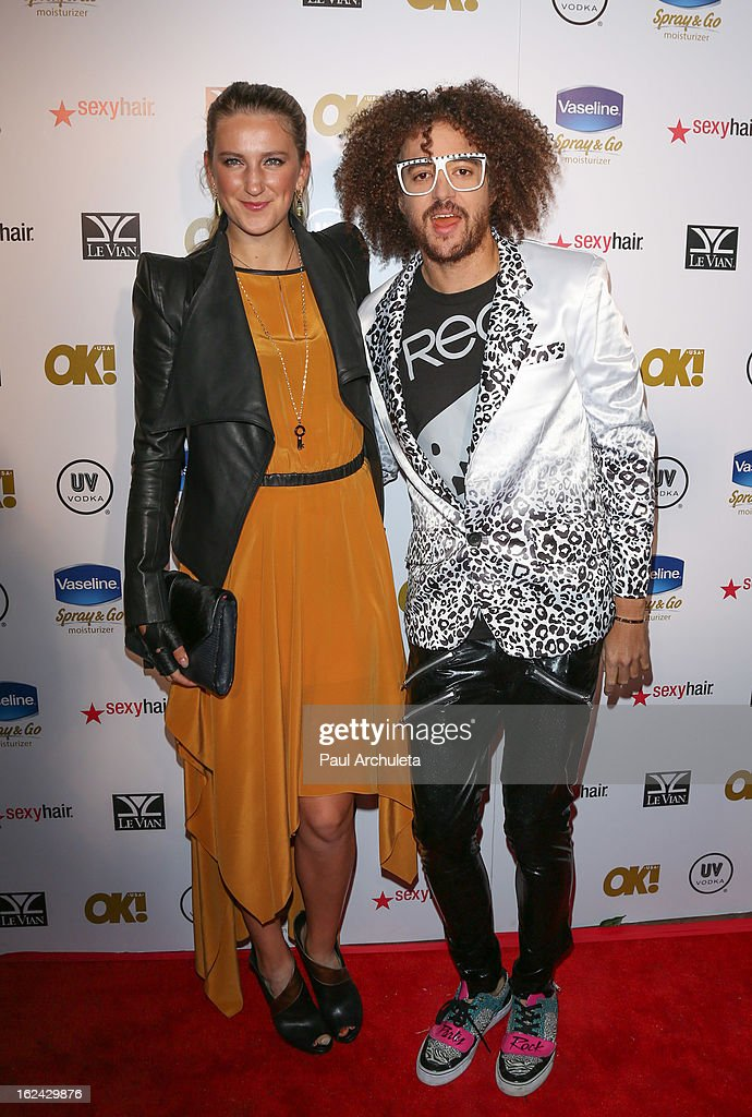 Pro Tennis Player Victoria Azarenka (L) and Recording Artist Redfoo (R) of LMFAO attend OK! Magazine's Pre-Oscar party at The Emerson Theatre on February 22, 2013 in Hollywood, California.
