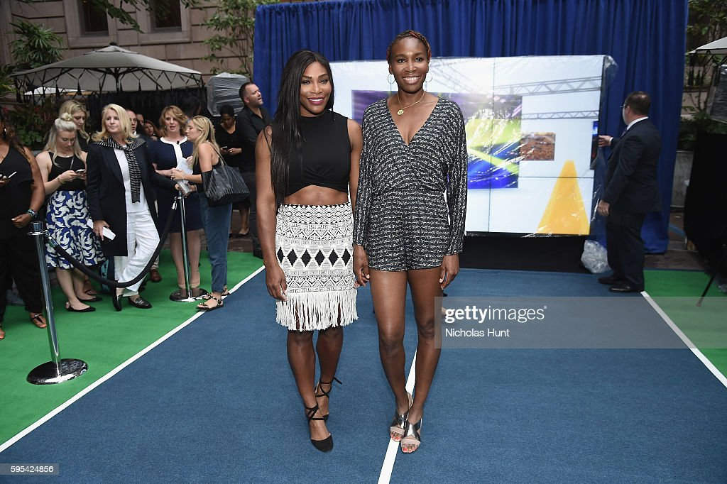 Pro Tennis players Serena Williams and Venus Williams play in the Wii Tennis Tournament at Lotte New York Palace on August 25, 2016 in New York City.