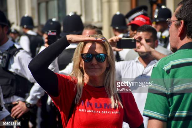 Pro Trump demonstrators gather at Parliament Square as a protest takes place in Central London against the US President Donald Trumps visit to the UK...