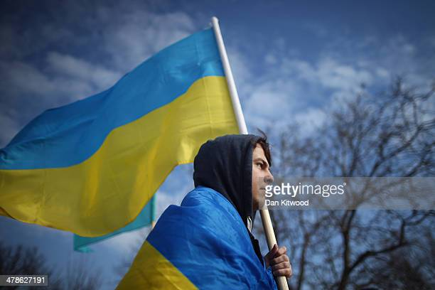 A pro Ukrainian protester against the forthcoming referendum in Crimea walks along the road on March 14 2014 in Simferopol Ukraine As the standoff...