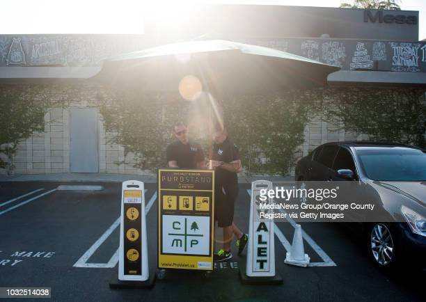 Pro Valet manager Vladimir Striganov left and valet Dan Salee man one of two valet podiums at The Camp in Costa Mesa outside the Mesa Lounge Tuesday...