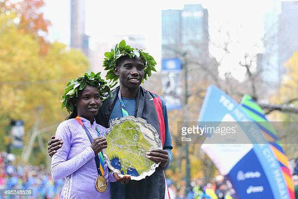 Pro Women's division winner Mary Keitany of Kenya left poses with Pro Men's division winner Stanley Biwott of Kenya during the 2015 TCS New York City...