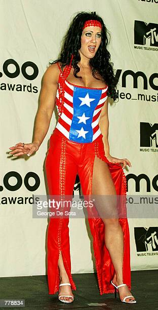 Pro wrestler Chyna poses for photographers September 7 2000 at the MTV Awards at Radio City Music Hall in New York City