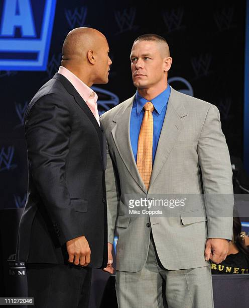Pro wrestler Dwayne The Rock Johnson and pro wrestler John Cena attend the WrestleMania XXVII press conference at Hard Rock Cafe New York on March 30...