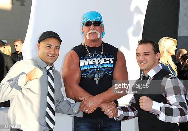 """Pro wrestler Hulk Hogan with MMA fighters Eddie Alvarez and Michael Chandler arrive at Spike TV's """"2011 Video Game Awards"""" at Sony Studios on..."""