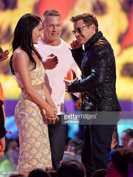 Pro wrestlers Nikki Bella and John Cena and actor Robert Downey Jr onstage at Nickelodeon's 27th Annual Kids' Choice Awards at USC Galen Center on...