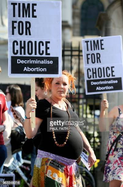 Proabortion protestors hold placards during a demonstration calling for abortion to be legalised in Northern Ireland outside Belfast city hall in...