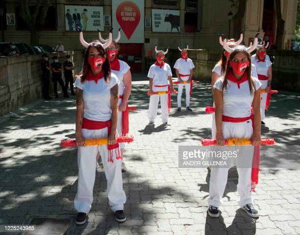 Proanimal rights activists celebrate the cancellation of the San Fermin Festival's bullfights and bullrunning during a demonstration called by the...
