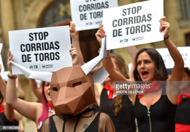 Proanimal rights activists hold banners that reads Stop bullfighting during a protest against bullfighting and bullrunning called by the People for...