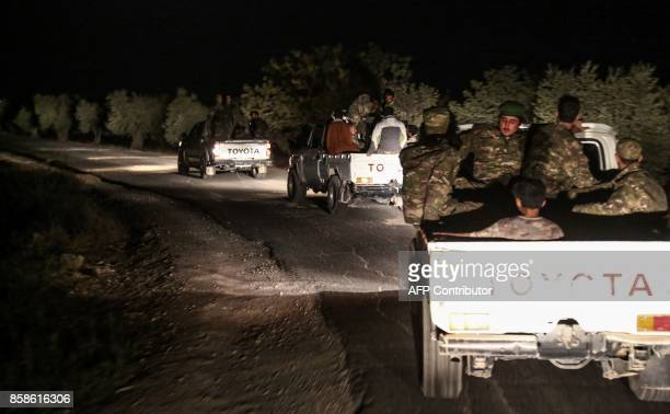 ProAnkara Syrian rebel fighters are seen riding on pickup trucks near the village of Hawar Killis along the SyrianTurkish border in the northern...