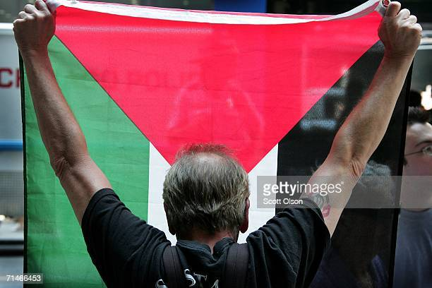 ProArab demonstrator holds a Palestianian flag during a rally supporting Israel's military action against Lebanon July 17 2006 in Chicago Illinois...