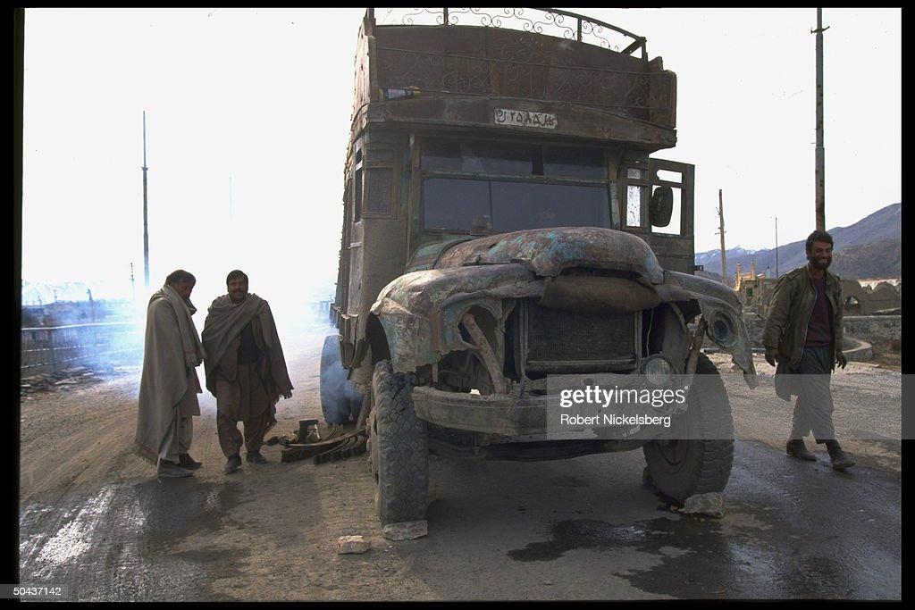 Prob. Rabbani govt. forces w. truck on m : News Photo